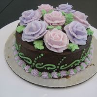 Wilton Class Final Cake This is an all chocolate cake with chocolate icing and buttercream roses.