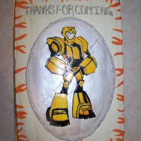 "Transformer Cake Transformer Bumblebee? birthday cake for a 6-year-old boy. Chocolate and vanilla cake, buttercream icing. The oval ""plaque"" with..."