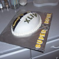 New Orelans Saints Cake For Superbowl Xliv Vanilla almond cake with vanilla buttercream, black and white fondant, x-acto knife cut fondant 'saints' logo painted with yellow...