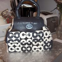 Coach Bag Cake This was my first attempt at a purse cake. Fondant covered with gumpaste patches and appliques. This cake stands about 8 inches tall, 5...