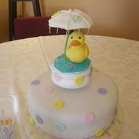 Baby Duck Baby shower cake for my daughter. Covered in fondant with fondant buttons and umbrella. The duck topper is a toothbrush holder, I covered...
