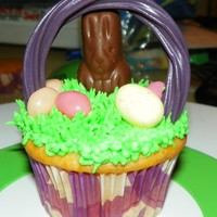 Easter Basket Cupcake  Easter basket cupcakes. I actually made 50 of these and I used rainbow Twizzlers for the handles so I had many different color handles,...