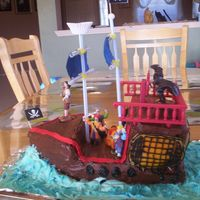 Pirate Ship Cake This is actually the cake that got me into making cakes... My son wanted the HEB pirate ship for his birthday, but I couldn't afford...