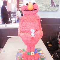 Elmo chocolate cake with cherry filling and italian buttercream frosting. Head, arms and legs of RKT. I made the RKT a little too chewy (my...