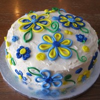 Flowers On Buttercream I got this idea from another CC'er. Hers is much nicer, though! I had no idea how hard and boring it would be to roll out all the...