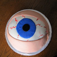 Eyeball Inspired by many of you here at CC! Chocolate cake, with spiced chocolate filling and fondant covering.