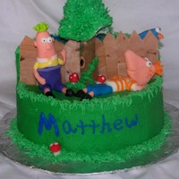 Phineaus & Ferb Lots of Fondant.... The boys, fence, Tree Trunk, mushrooms, Perry.Butter cream cake. I LOVED making this cake sooo much fun!!!