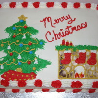 Christmas Tree And Fireplace Cake white almond cake filled with strawberry with buttercream icing.