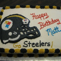 Steelers Helmet White almond cake with buttercream icing.