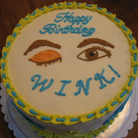Wink's Birthday Cake White vanilla cake filled with strawberry with vanilla buttercream icing. The person's nickname is Wink so made a winking eye and open...