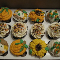 Fall Cupcakes Pumpkin caupcakes filled with cinnamon cream cheese decorated with cream cheese icing.