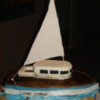 Seal Boat Chocolate germain cake, nut coconut filling, fondant covered, gum paste details, 99% edible (only the dowel is not). This cake was made for...