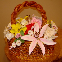 Basquet Of Flowers It was 100% edible, basquet made by hand out fondant strips, the handle was made out of gum paste, the gum paste flowers of various colors...