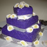 Purrple Passion 3 tiers cake. Buttercream, chocolate cake, lemon cake with raspberry filling. gum paste flowers. The color match the decoration of the...