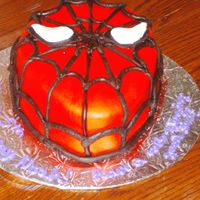 Spiderman  This was for my nephew's 5th birthday. All fondant decoration, chocolate cake with cherry cheescake filling. He loved it but wished he...