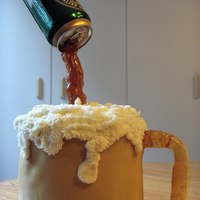 Beer Mug   carrot cake covered with MMF with sugar handle and foam is buttercream