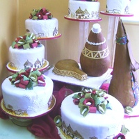Traditional Wedding Cake   ROUND CAKES,A CALABASH AND TWO GOURDS FROM TWO DIFFERENT COMMUNITY IN KENYA ie; kikuyu and maasai.