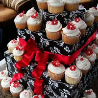 Red & White Cupcakes These are some cupcakes I made for a friend of a friend's bridal shower. Her colors are red & white, the lady I did them for...