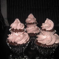 Tiered Cupcake Tiered chocolate cupcakes with raspberry icing and silver sugar crystals.