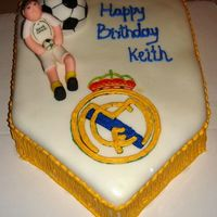 Real Madrid - Soccer Cake - Made For A Raul Fan Chocolate cake with buttercream frosting, covered in MMF. The soccer ball is a chocolate cake too covered in MMF and hand painted. The...