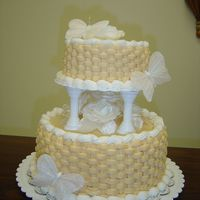 First Wedding Cake Two-Tiered Basket Weave Wedding Cake. White Cake/Buttercream Icing.