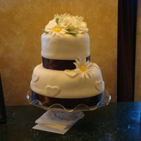 Rose And Daisy Wedding Cake   My first wedding cake. It was hot and the whole thing started to tilt and the fondant began to buckle, but they loved it.