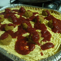 Spaghetti Cake Cream cheese frosting with cake meatballs and strawberry sauce