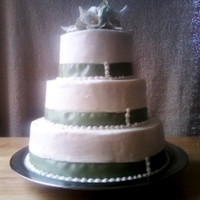 Calla Lily Green And White Wedding Cake This is a WASC cake 12/9/6, with buttercream. Real ribbon and fondant calla lillies. Thanks for looking!