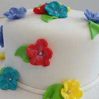 Tropical Flowers This is a 6inch pina colada cake with pineapple filling. TFL