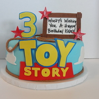 Toy Story Cake Made using the cricut cake, designed the clouds and used the font verdana for the words and numbers it was the closest font I could come up...