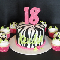 Zebra Print Cake Zebra cake with coordinating cupcakes, first zebra cake and it was fun! TFL
