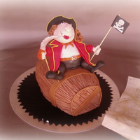 Pirate Cake And Barrel  Thi is for my nephew. The barrel is the cake and the stomach of the pirate is a very little dome cake. The barrel is Italian spongecake,...