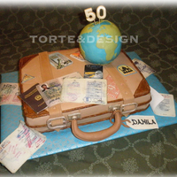 Globetrotter: Luggagecase And Globe  This is a cake for a real globetrotter woman, who have travelled all over the world, since twenty! Now in Italy. She lived in the East and...