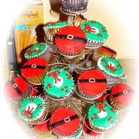Christmas Cupcakes Christmas wreaths and Santa's belly. White and chocolate cupcakes all decorated in buttercream icing. Thanks for looking!