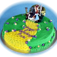 "Wizard Of Oz Birthday Cake A 10"" round marble cake with raspberry filling. I used Indydebi's buttercream icing. The topper is actually a Christmas ornament..."