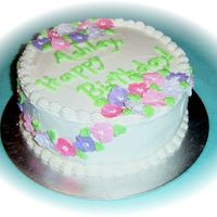 Floral Birthday Cake A 9 inch round, white cake with raspberry filling. Iced with buttercream, RI flowers. Thanks for looking!