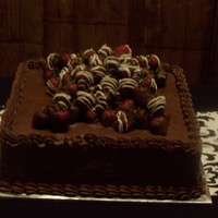 Yummy Groom's cake. Butter cream with chocolate covered strawberries.