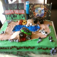 Monster Trucks I did this cake for my grandson's 5th birthday. He wanted monster trucks, dirt and water on it. The trucks I purchased and they came...