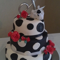 "Wedding Cake Wedding cake with polka dots and red roses, inspiration from the movie ""Because I said So"". Top tier Strawberry, middle tier..."