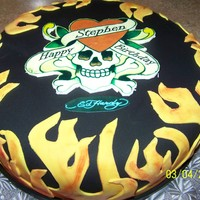 Ed Hardy I did this Ed Hardy cake for a friend's husband. Vanilla cake with strawberry cream cheese filling covered in fondant.