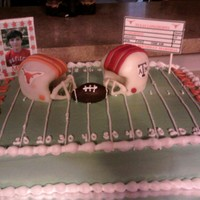 Longhorns Vs. Aggies My stepson loves the Longhorns and wanted them against the Aggies.Vanilla cake with buttercream icing. The helmets are rice crispy treats...