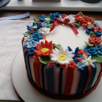 Red White And Blue Floral I wanted a brightly coloured cake for my nans 70th birthday, I think the colours went well together and it went down well.