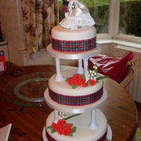 Scottish Themed Wedding Cake My forst go at pillars. I was terrified it was going to fall over. (it didnt)!! Two tiers are fruit and one is sponge.