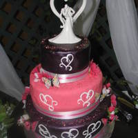 Pink Wedding Cake This was all cake done in red velvet, with a buttercream icing and choc fondant.....TFL