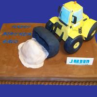 Bosses B-Day Cake Choclate cake with raspberry filling. Covered in choclate butter cream. Front end loader made of rice crispy and covered in fondant with...