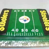 Steeler Time 1/2 sheet marbled white & chocolate, with buttercream frosting. Emblem,letters and numbers are in fondant. Thanks for looking