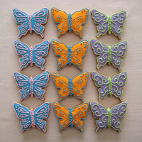Bright Butterflies!! I made 18 of these cookies for my family and other people as a present to try out my new butterfly cookie cutter i got for my b'day a...