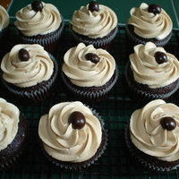 Mocha Cupcakes Mocha Cupcakes with espresso buttercream frosting topped with a chocolate covered coffee bean
