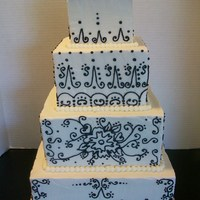 "Black & White Scroll buttercream covered 10"" 8"" 6"" & 4"". Scroll work done with Royal Icing."
