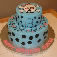 13Th Birthday Skull Cake This is exactly what she wanted! Blue cake, black circles, black stars, black scrolls with pink hearts and a skull on top. Buttercream cake...